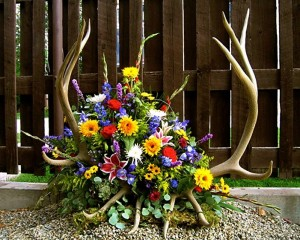 arrangement with antlers brought in by customer
